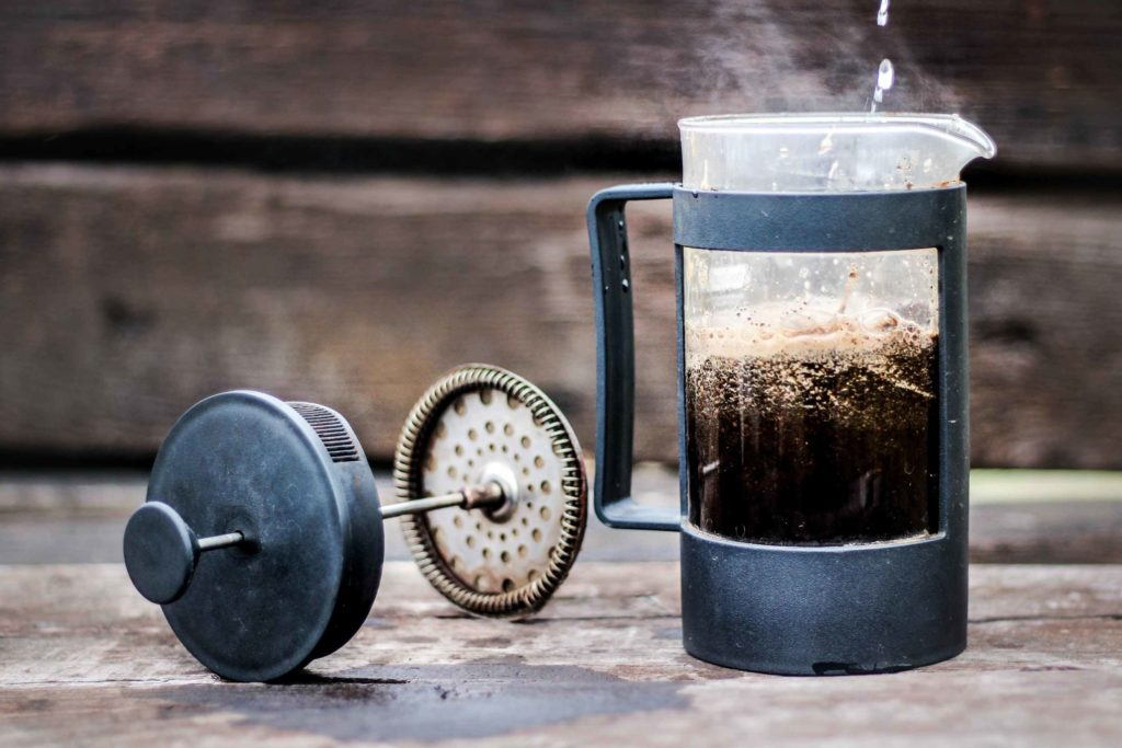 French Press Coffee Maker pictured with water being added.